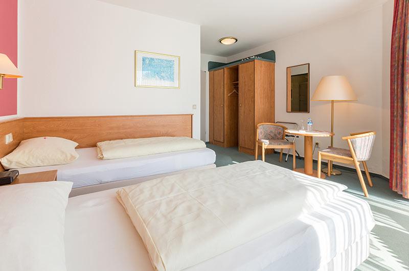 Zimmer mit Betten
